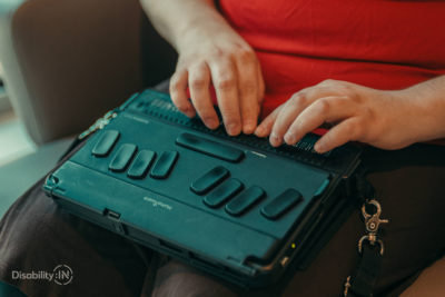 Close up shot of someone typing on a braille notetaker.