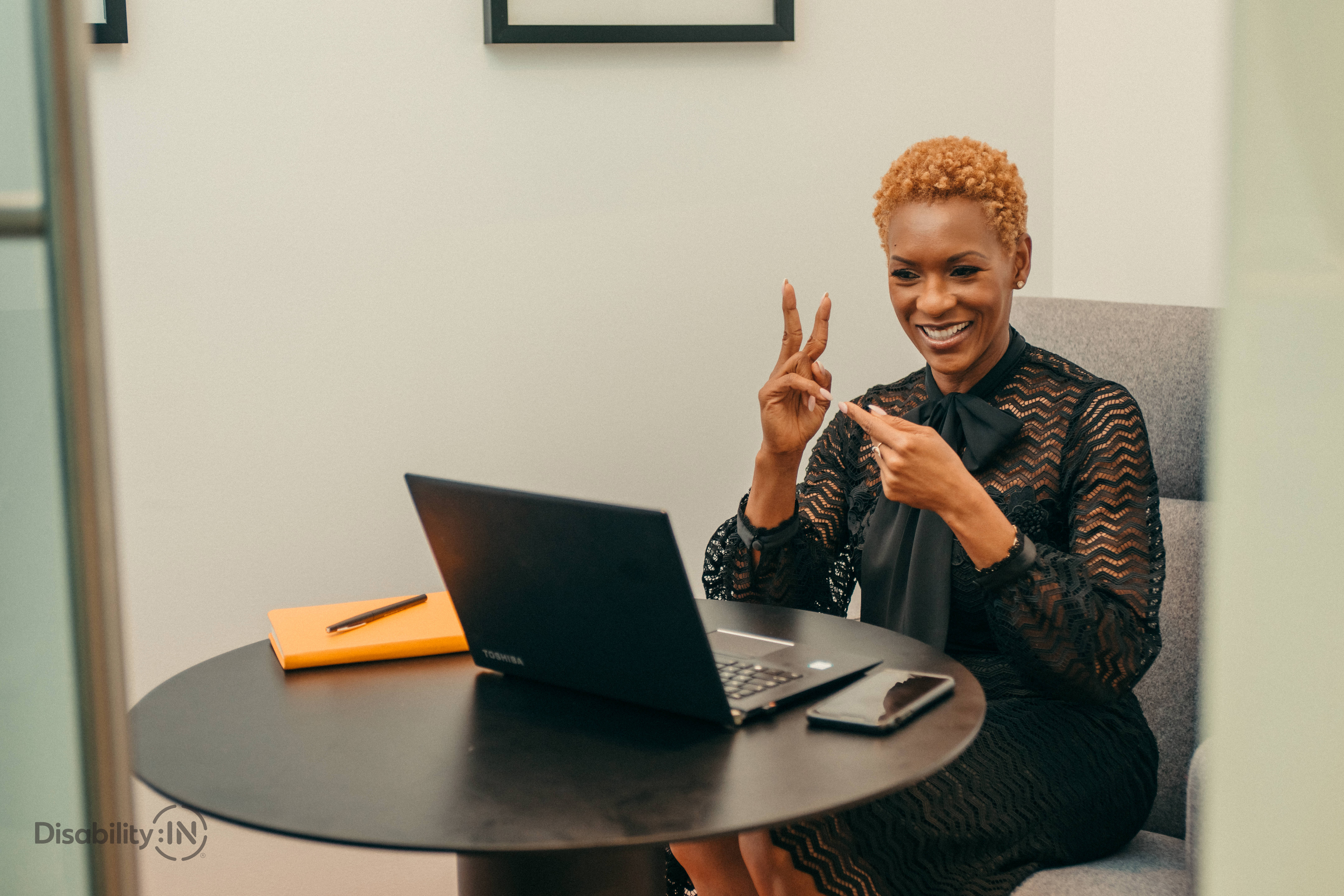 Woman uses sign language in a video teleconference
