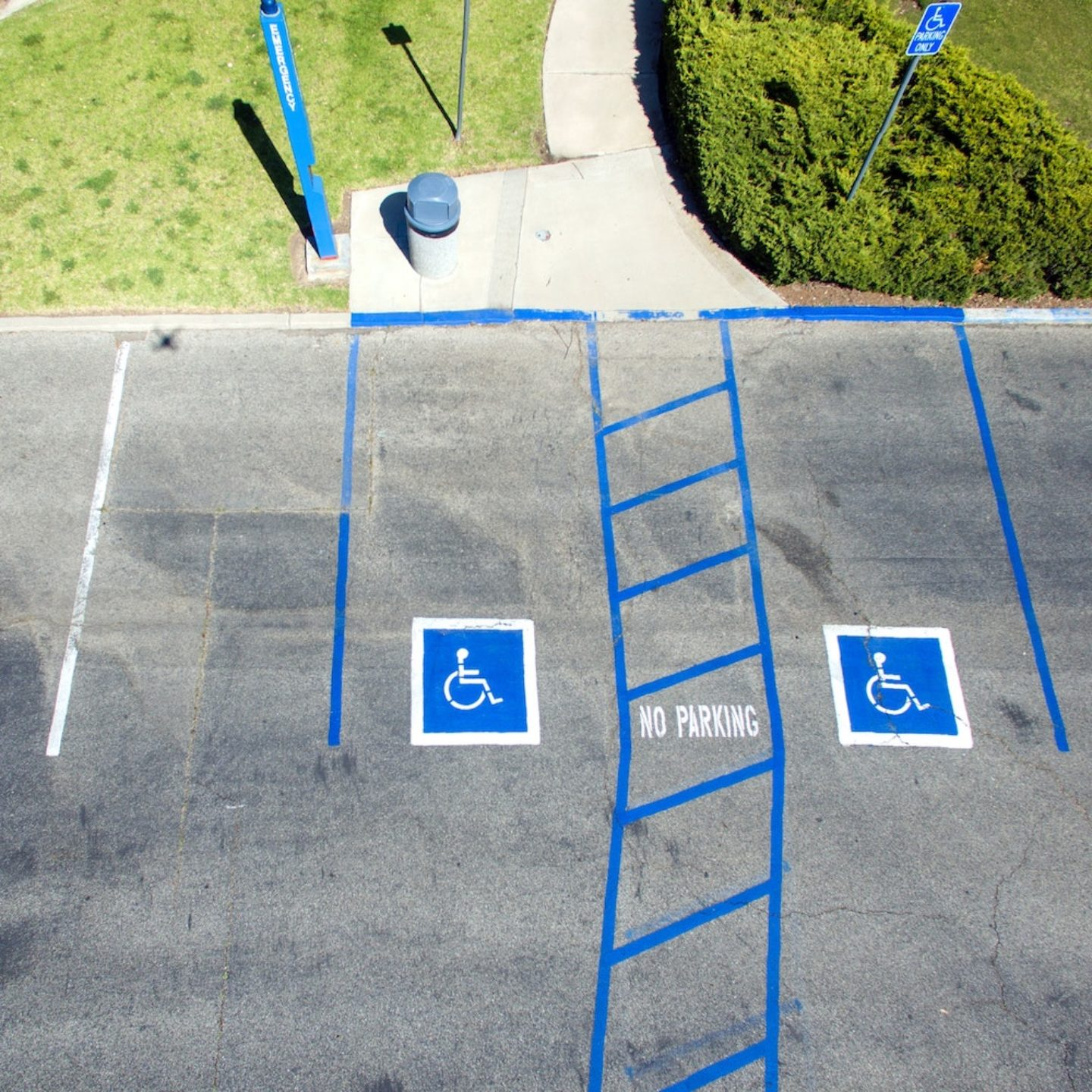parking lot with international symbol of access and access ways painted