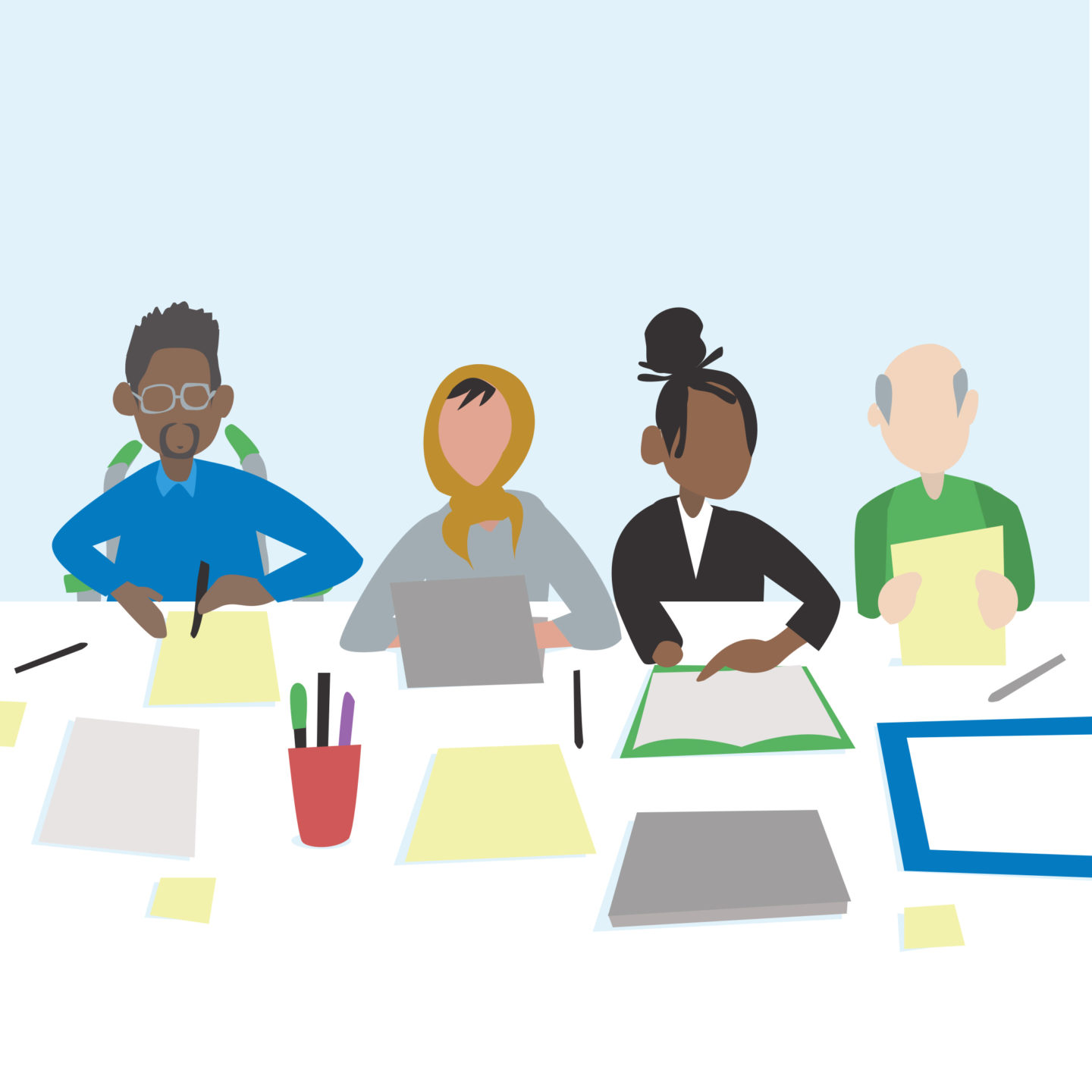 Inclusive Culture: a group of diverse people in an office setting working on a project